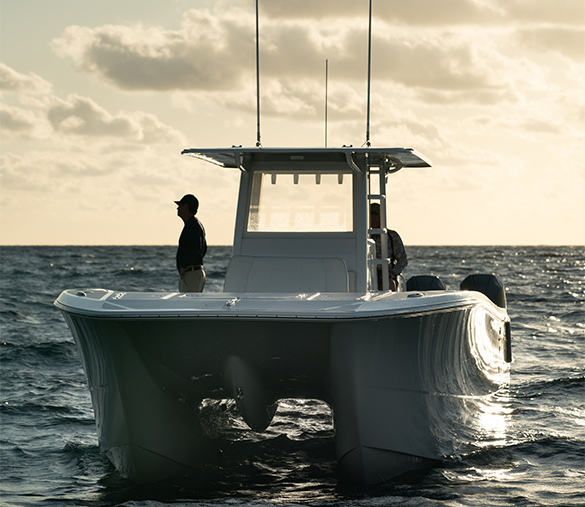 Man observing the waters in a spectacularly crafted 35 ft. Invincible catamaran for sale.