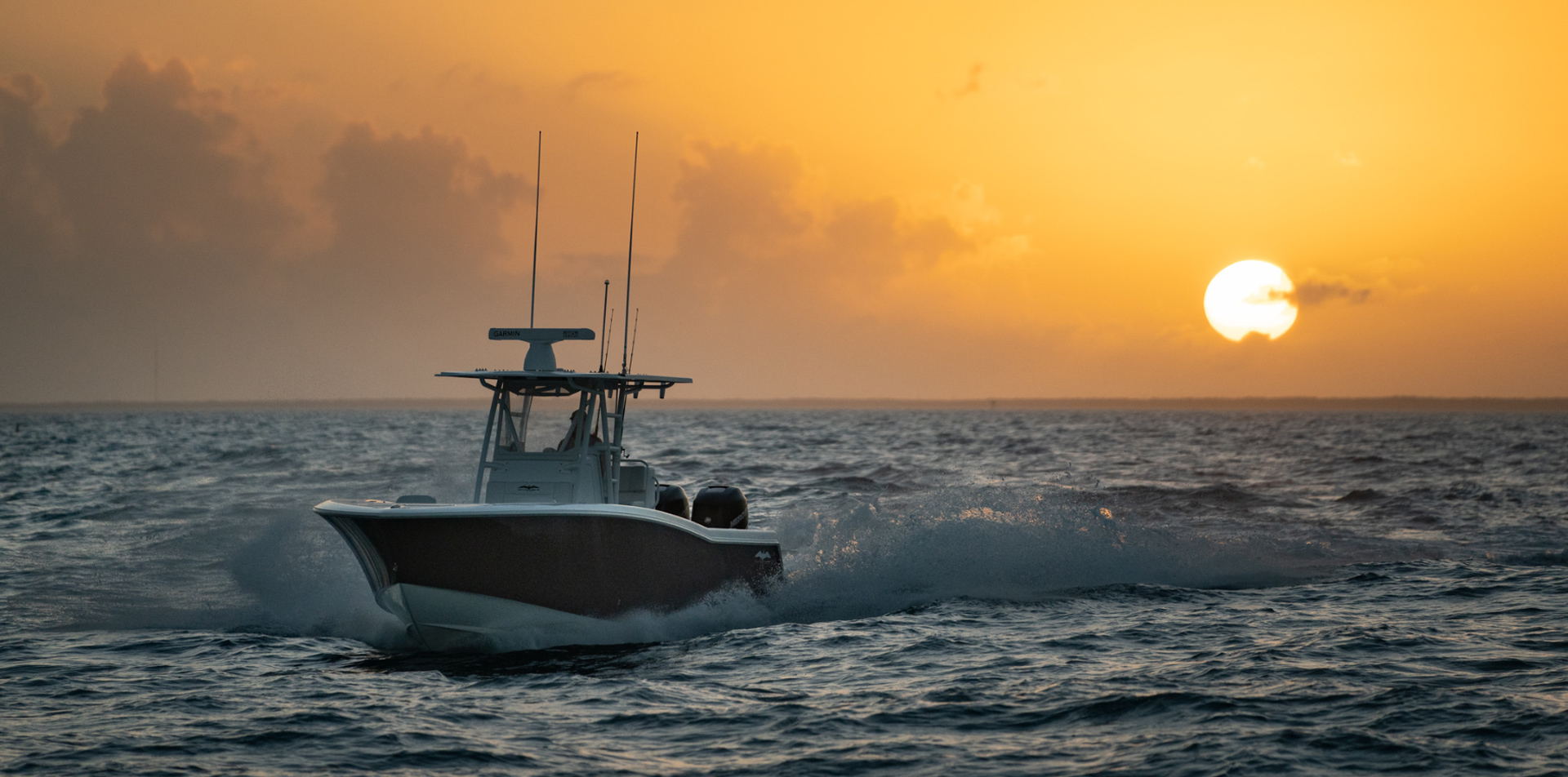 33 ft Open Fisherman cruising waters while the sun is setting.