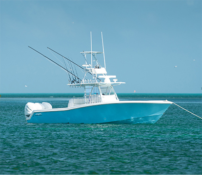 The ultimate 39 foot boat: Invincible's Open Fisherman mono-hull anchored.