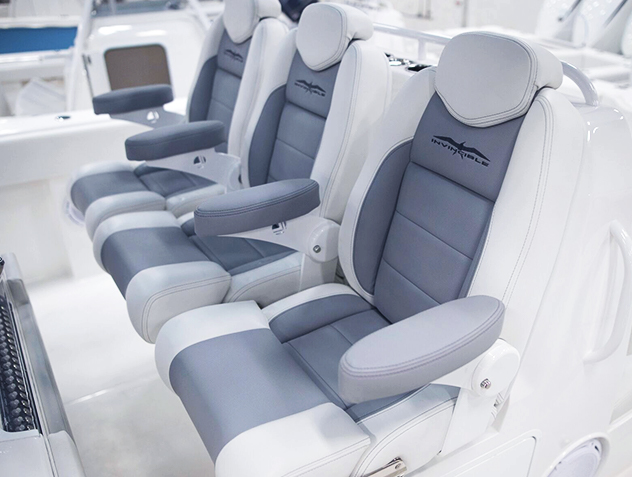 Invincible's custom deluxe gray and white seating on 40 ft. Catamaran, built for performance and comfort - dominating the industry.