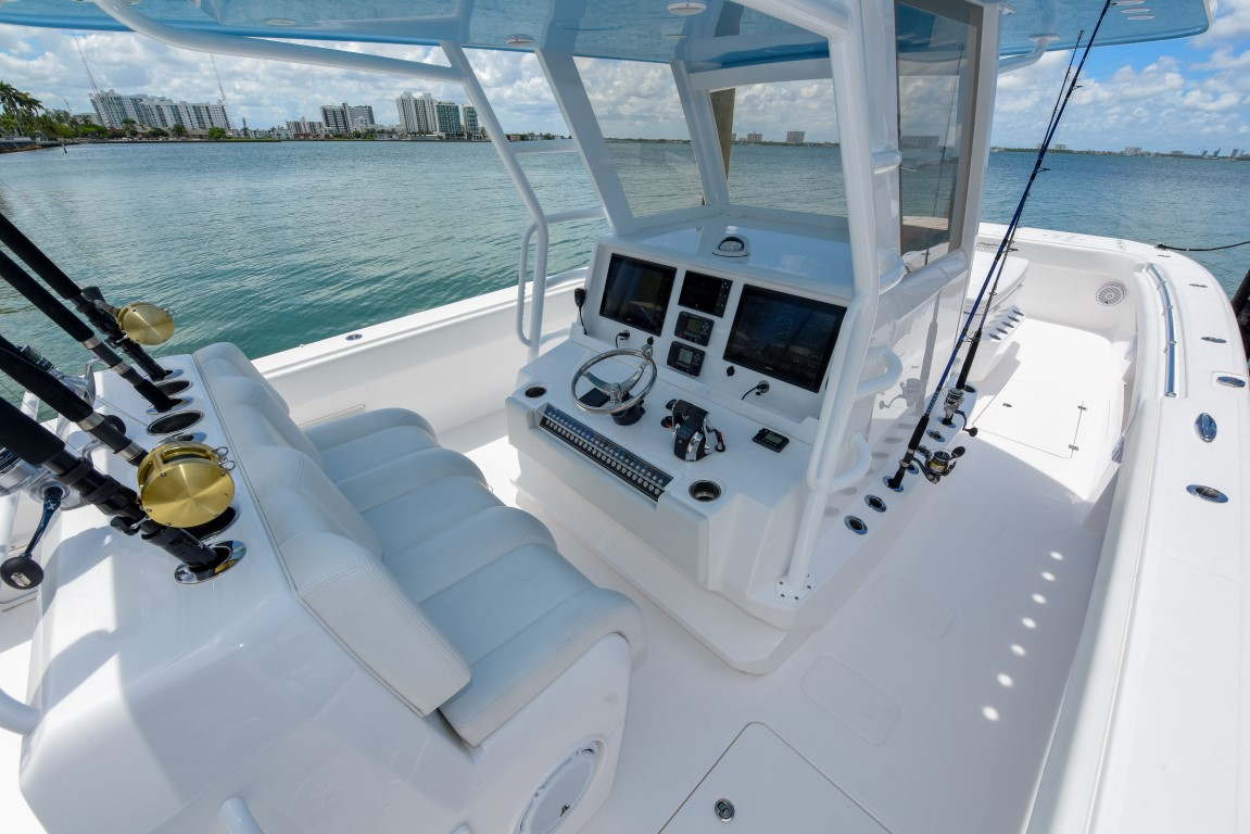 Invincible's state of the art console with digital navigational system and cushioned seating on 37 ft. Catamaran.