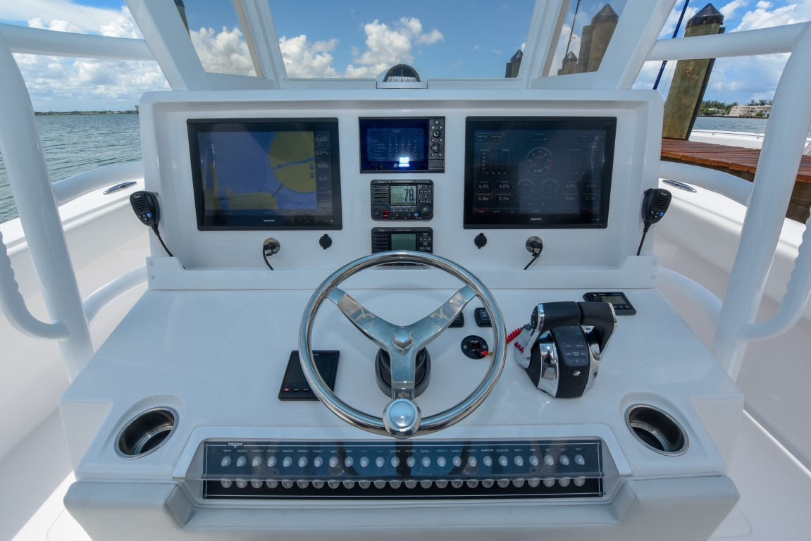 Next-level console with digital electronics, power steering, and navigational system built for fishing on 37 foot Catamaran.