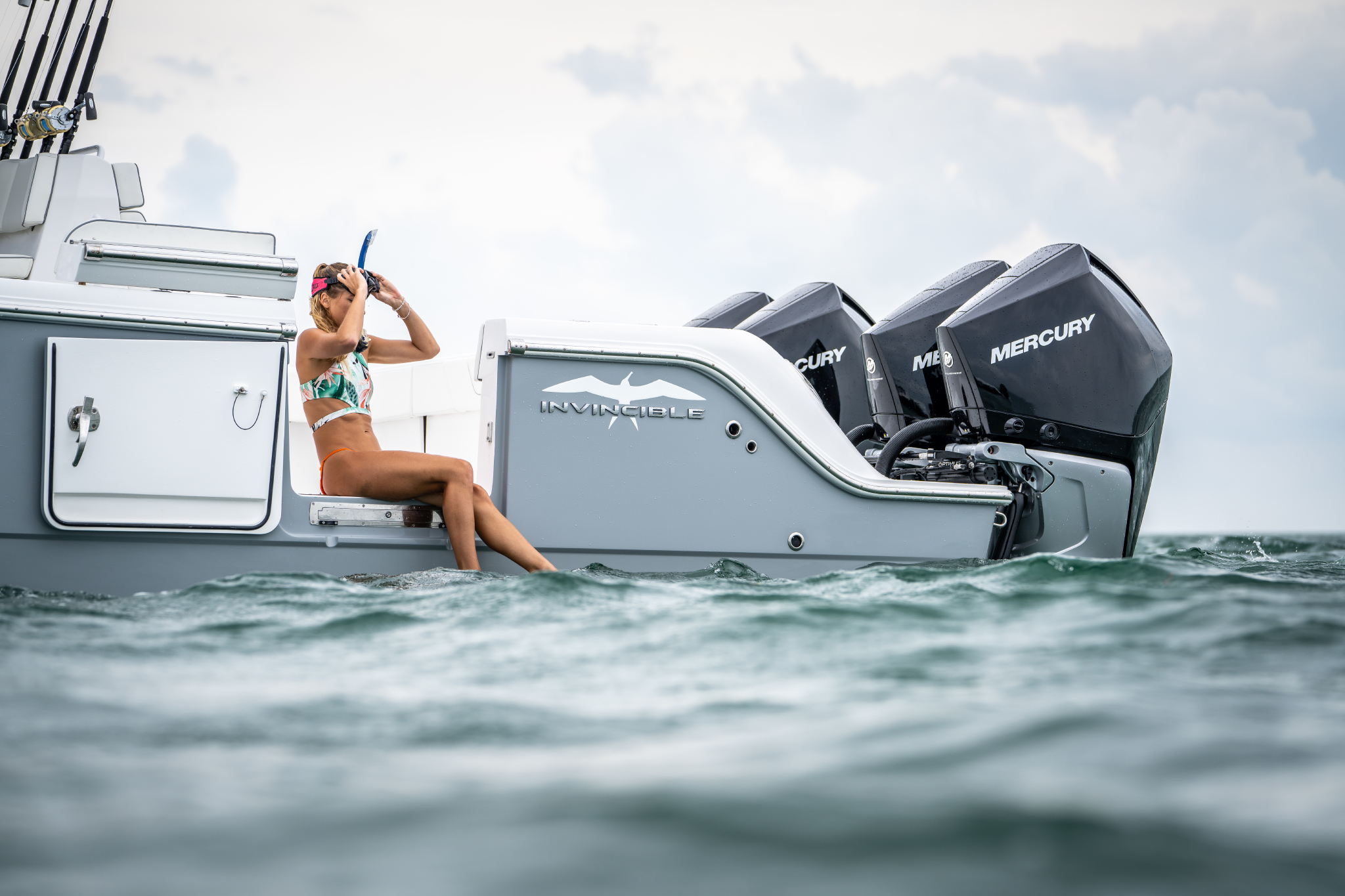 Woman ready to snorkel on Invincible's 35 foot Catamaran.