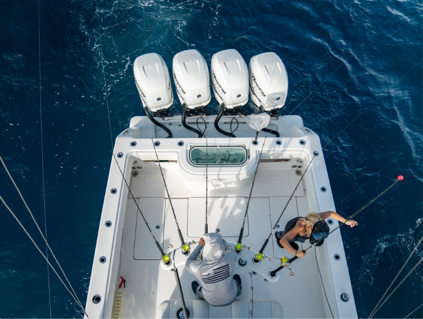 Aerial view of 42 ft. boat cockpit including deluxe rod holders, livewell, and motors.
