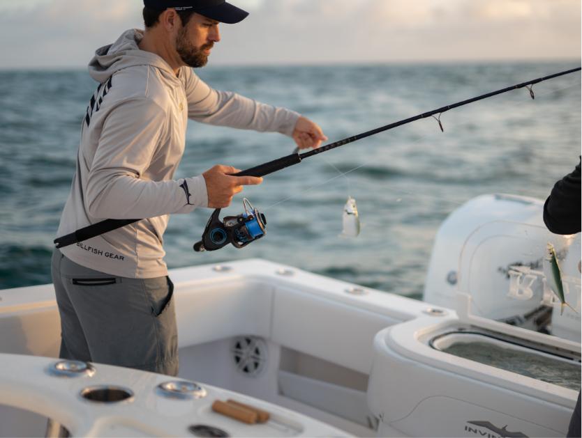Fisherman casting bait on Invincible's 42 ft. mono-hull.