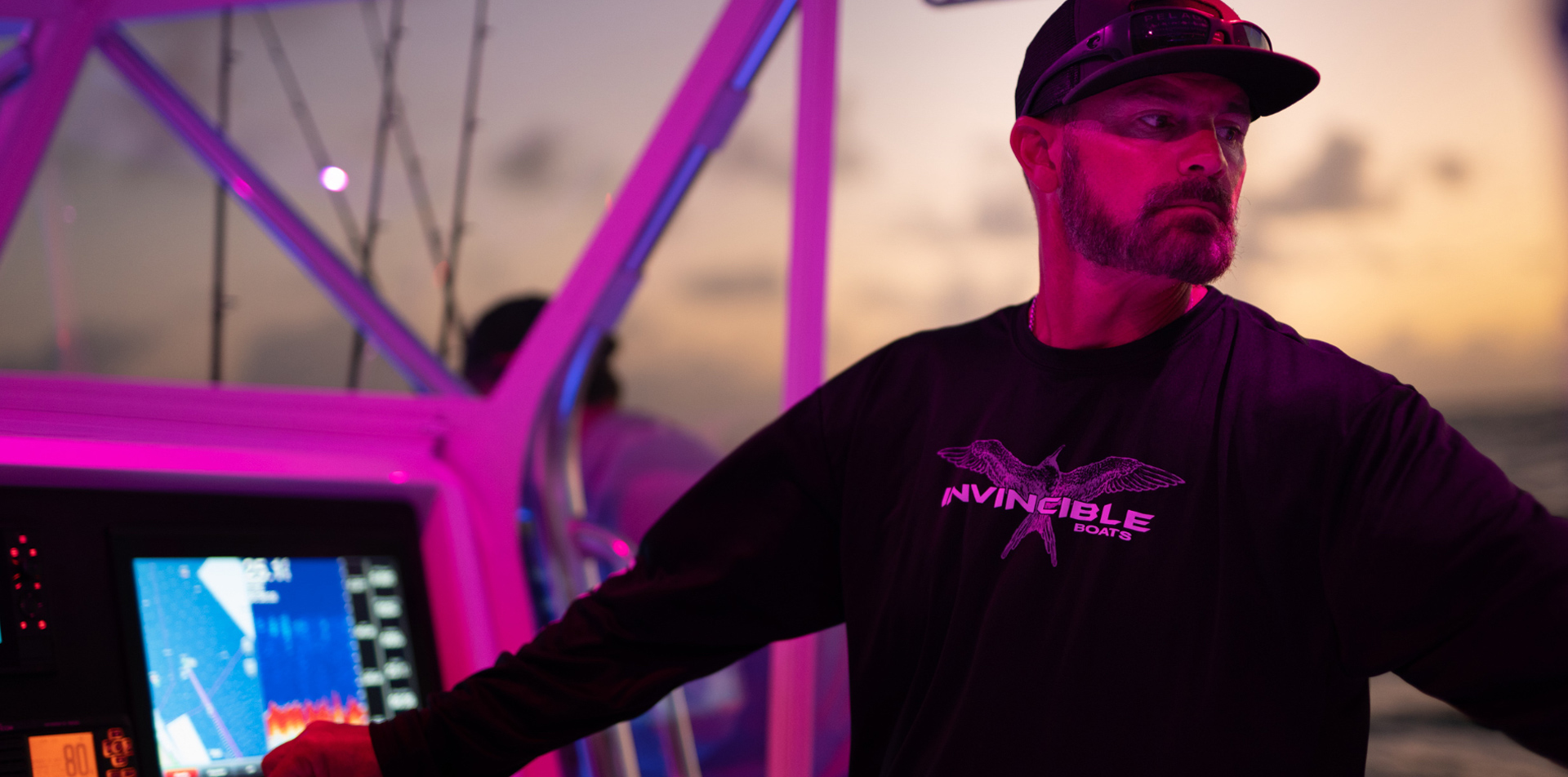 Competitive fisherman captaining an Invincible Boat.